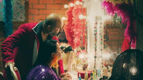 man and woman looking at mirror
